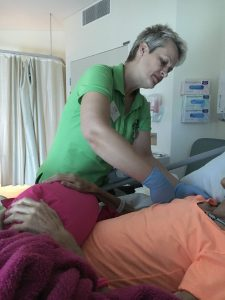Andrea providing massage to a terminally ill patient